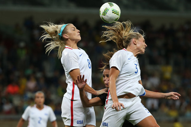 United States' Julie Johnston, left, and Allie Long, right, go for a header during a women's Olympic football tournament match against New Zealand at the Mineirao stadium in Belo Horizonte, Brazil, Wednesday, August 3, 2016. (Photo by Eugenio Savio/AP Photo)
