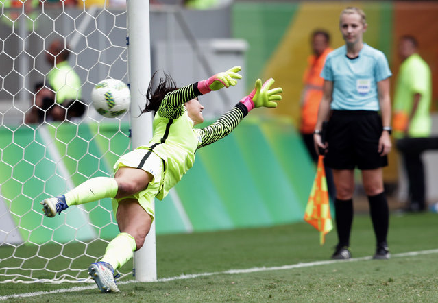 United States goalkeeper Hope Solo fails to stop a penalty during a penalty shoot-out in the quarter-final match of the women's Olympic football tournament between the United States and Sweden in Brasilia Friday August 12, 2016. The United States was eliminated by Sweden after a penalty shoot-out. (Photo by Eraldo Peres/AP Photo)