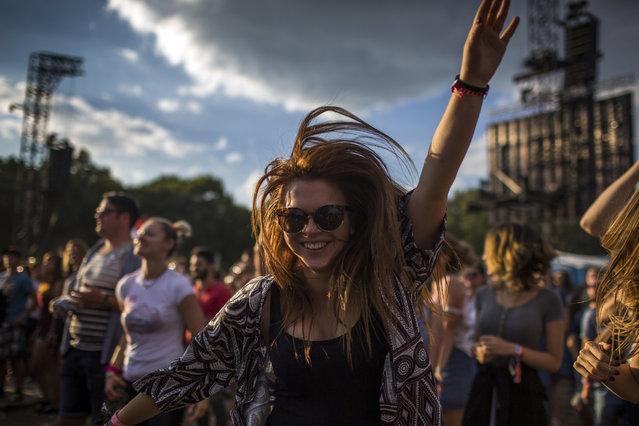 A festival-goer enjoy on Shipyard Island, the venue of the 24th Sziget (Island) Festival in Northern Budapest, Hungary, 12 August 2016. (Photo by Polyák Attila/Origo.hu)