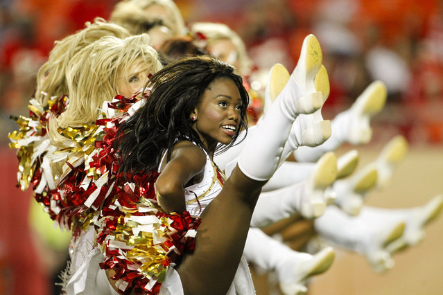 Kansas City Chiefs cheerleaders perform in the second half of an NFL preseason football game between the Kansas City Chiefs and the Cincinnati Bengals Thursday, August 7, 2014, in Kansas City, Mo. The Chiefs won 41-39. (Photo by Colin E. Braley/AP Photo)