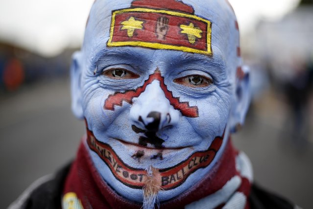 Britain Football Soccer, Burnley vs Swansea City, Premier League, Turf Moor on August 13, 2016. Burnley fan with face paint outside the stadium before the match. (Photo by Ed Sykes/Reuters/Action Images/Livepic)