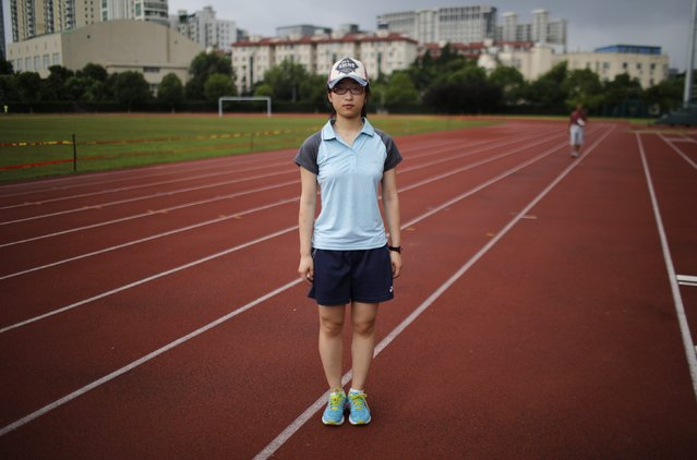 "Jiang Chencheng, who was born in 1993, poses for a photograph in Shanghai July 23, 2014. Chencheng said: ""I wouldn't like to have a brother or a sister because I would have to share the (family's) financial (resources) with them and it would be very difficult for our parents to send them to good universities"". (Photo by Carlos Barria/Reuters)"