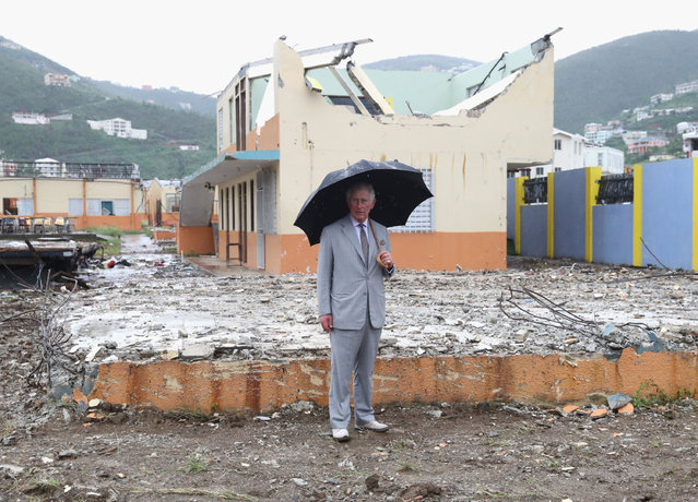 Prince Charles, Prince of Wales view the destroyed landscape left by the hurricane on November 18, 2017 in Antigua and Barbuda. The Prince of Wales is on a three day visit to the Caribbean to visit residents of a number of Islands who have been affected by the devastating hurricanes of Septmeber. (Photo by Chris Jackson/Getty Images)