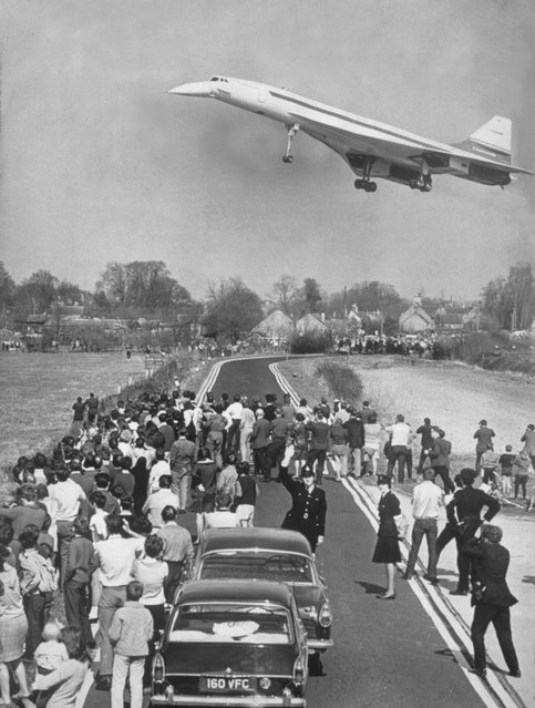 """Concorde's maiden flight, Fairford, Gloucestershire, 10 April 1969. """"Britain's Concorde 002 made a 21 minute flight into the seventies yesterday and gave Britain and France a possible seven year lead over any possible American rival. It was champagne in Bristol last night after a great day for Britain and her planemakers. Technology Minister Anthony Wedgewood Benn summed it up: I have never felt so proud to be British and I think my feelings are shared by everyone who watched and waited for this day"""". (Photo by SSPL/Getty Images)"""