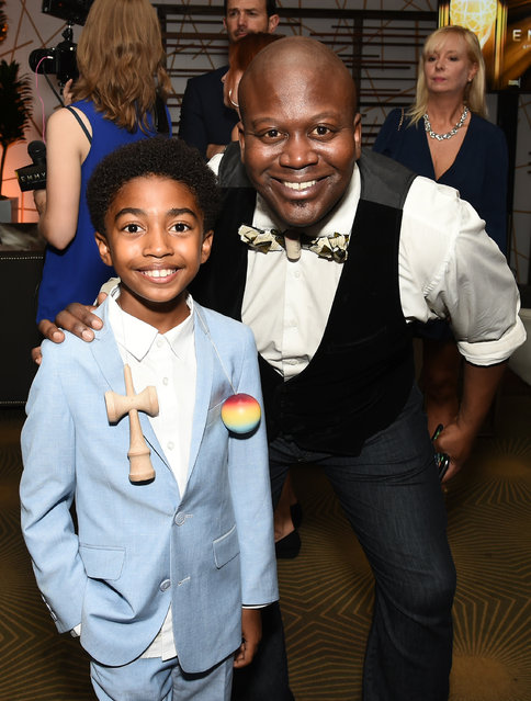 Miles Brown, left, and Tituss Burgess attend the Television Academy's 67th Emmy Awards Performers Nominee Reception at the Pacific Design Center on Saturday, September 19, 2015, in West Hollywood, Calif. (Photo by Charles Sykes/Invision for the Television Academy/AP Images)