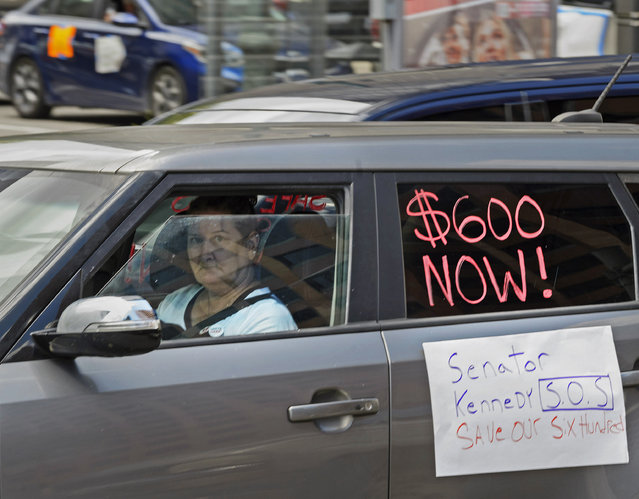 Motorists take part in a caravan protest in front of Senator John Kennedy's office at the Hale Boggs Federal Building asking for the extension of the $600 in unemployment benefits to people out of work because of the coronavirus in New Orleans, La. Wednesday, July 22, 2020. (Photo by Max Becherer/The Advocate via AP Photo)