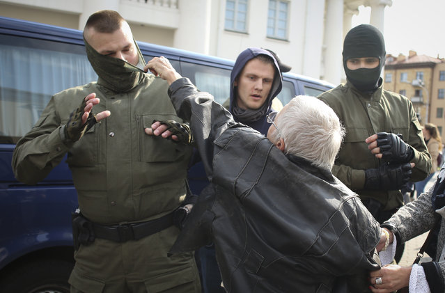 An elderly woman rips the mask off a police officer during an opposition rally to protest the official presidential election results in Minsk, Belarus, Saturday, September 12, 2020. (Photo by Tut.by via AP Photo)