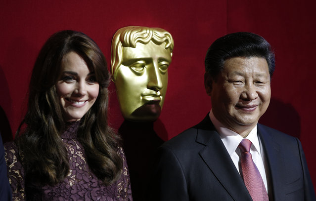 Chinese President Xi Jinping, right, and Britain's Kate, Duchess of Cambridge, attend a BAFTA presentation at Lancaster House in London, Wednesday, October 21, 2015, during a UK-China Creative Collaborations Summit. Britain and China are set to seal business contracts worth billions on Wednesday, the second day of President Xi Jinping's four-day State Visit. (Photo by Adrian Dennis/Pool Photo via AP Photo)