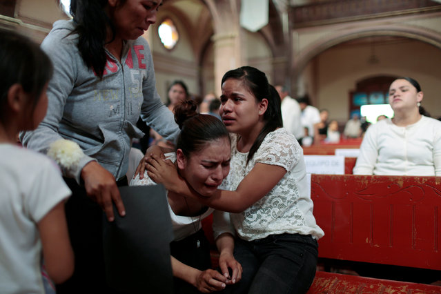 Parishioners react during a funeral mass for priest Jose Alfredo Lopez Guillen, who was killed by unknown assailants, at the Saint Trinity church in the town of Janamuato, in the state of Michoacan, Mexico, September 26, 2016. (Photo by Alan Ortega/Reuters)