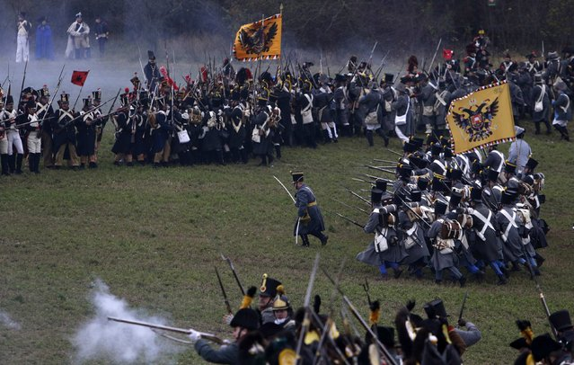 History enthusiasts, dressed as soldiers, fight during the re-enactment of Napoleon's famous battle of Austerlitz near the southern Moravian town of Slavkov u Brna November 29, 2014. (Photo by David W. Cerny/Reuters)