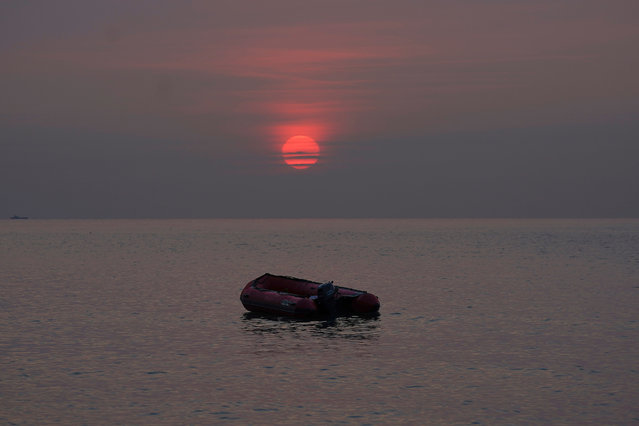 An empty migrant dinghy floats off the beach at St Margaret's Bay after the occupants landed from France on September 11, 2020 in Dover, England. More than 1,468 migrants, some of them children, crossed the English Channel by small boat in August, despite a commitment from British and French authorities to step up enforcement. (Photo by Christopher Furlong/Getty Images)