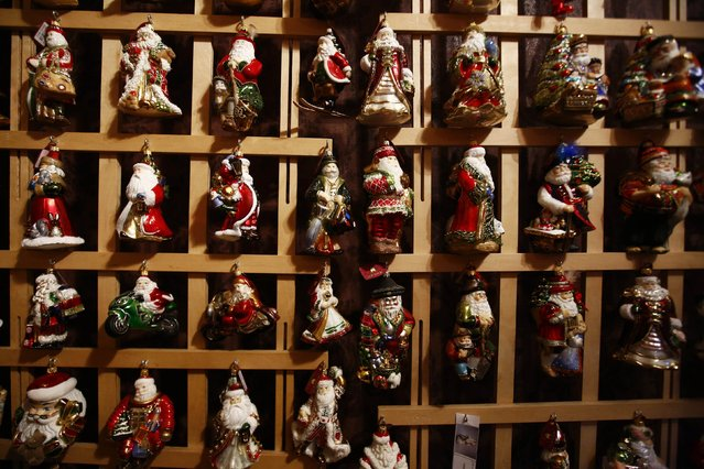 Santa Claus shape glass decorations are displayed at the Silverado manufacture of hand-blown Christmas ornaments in the town of Jozefow outside Warsaw December 2, 2014. (Photo by Kacper Pempel/Reuters)