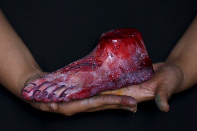 A bloody zombie foot made of gummy candy and red jelly is pictured at the Zombie Gourmet homemade candy manufacturer on the outskirts of Mexico City October 30, 2015. (Photo by Carlos Jasso/Reuters)