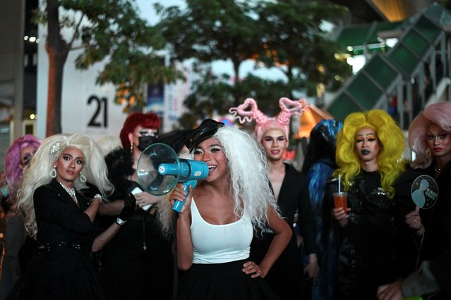 Transgender drag queen Aunchalee Pokinwuttipob, better known by the stage name, Angele Anang, 26, uses a megaphone during an LGBT rally against Prime Minister Prayuth Chan-ocha and to call for reforms to the monarchy, in Bangkok, Thailand, October 25, 2020. (Photo by Chalinee Thirasupa/Reuters)