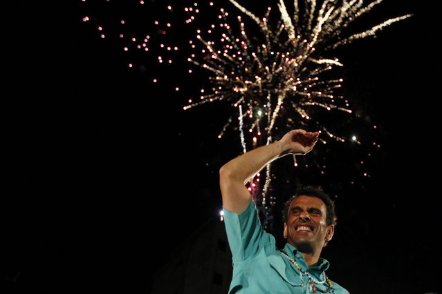 Venezuela's opposition leader and presidential candidate Henrique Capriles greets supporters during a campaign rally in the state of Zulia April 10, 2013. Venezuelans will hold presidential elections on April 14. (Photo by Carlos Garcia Rawlins/Reuters)
