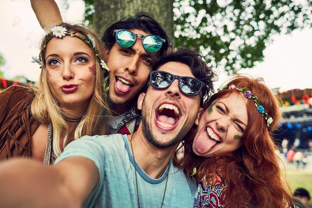 Group of friends having fun at a music festival. (Photo by Flashpop/Getty Images)