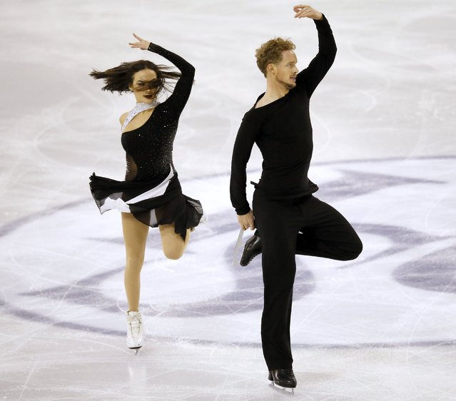 Madison Chock and Evan Bates of the U.S. perform during the ice dance skating event at the ISU Grand Prix of Figure Skating final in Barcelona December 13, 2014. (Photo by Albert Gea/Reuters)