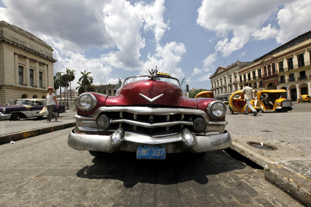 A vintage taxi waits for customers at Cuba's Capitol in Havana, May 27, 2009. (Photo by Desmond Boylan/Reuters)