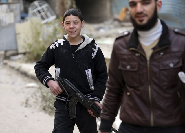 A young Free Syrian Army fighter holds a rifle in Haresta neighbourhood of Damascus January 16, 2013. (Photo by Goran Tomasevic/Reuters)