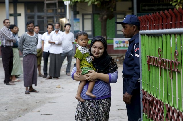 A Muslim woman leaves a polling station after casting her ballot in a mixed Muslim, Buddhist and Hindu neighbourhood during the general election in Mandalay, Myanmar, November 8, 2015. (Photo by Olivia Harris/Reuters)