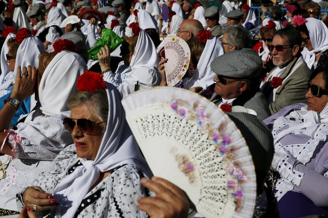 "People dressed in traditional Madrid attire as ""chulapos"" and ""chulapas"" take part in an open-air mass to celebrate Madrid's patron saint La Almudena Virgin in Madrid, Spain, November 9, 2015. (Photo by Susana Vera/Reuters)"