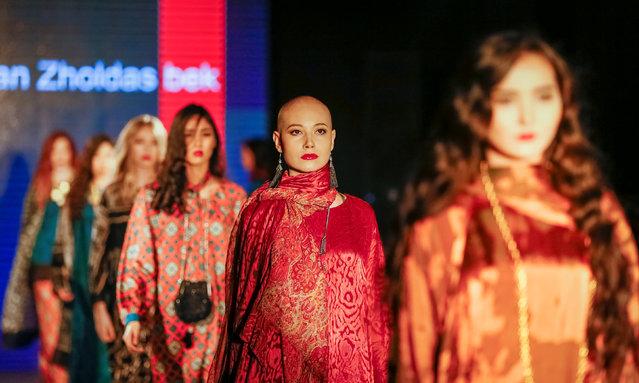 Models present creations by Kazakhstan's designer Yerlan Zholdasbek during Kazakhstan Fashion Week in Almaty, Kazakhstan April 10, 2018. (Photo by Shamil Zhumatov/Reuters)
