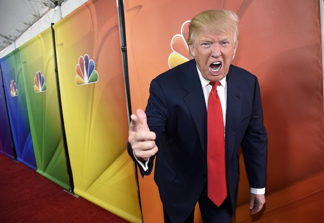 "In this January 16, 2015 file photo, Donald Trump, host of the television series ""The Celebrity Apprentice"", mugs for photographers at the NBC 2015 Winter TCA Press Tour in Pasadena, Calif. The skyline shimmers, the music pulses and Donald Trump's helicopter swoops in for a landing. Oozing authority, the billionaire strides purposefully, in slow-motion, for added impact, toward some important matter of business in ""New York, my city"", as Trump calls it. Week by week, year by year, 14 seasons of ""The Apprentice"" or ""Celebrity Apprentice"" served as a grand homage to all things Trump, running from 2004 to 2015. (Photo by Chris Pizzello/Invision via AP Photo)"