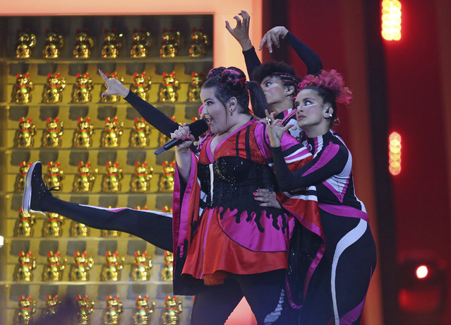 """Netta from Israel performs the song """"Toy"""" in Lisbon, Portugal, Saturday, May 12, 2018 during the Eurovision Song Contest grand final. (Photo by Armando Franca/AP Photo)"""