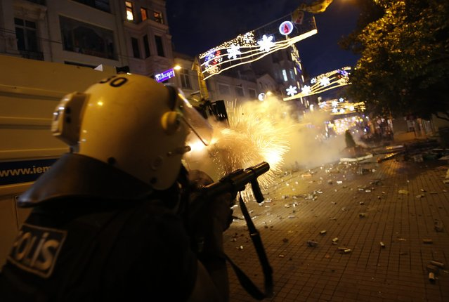 Riot police use tear gas to disperse the crowd during an anti-government protests at Taksim Square in central Istanbul May 31, 2013. (Photo by Murad Sezer/Reuters)