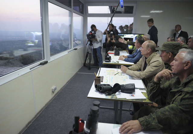 Vladimir Putin observes troops in action during a training exercise named Kavkaz 2012 in the Krasnodar region September 17, 2012. (Photo by Alexei Druzhinin/Reuters/RIA Novosti)