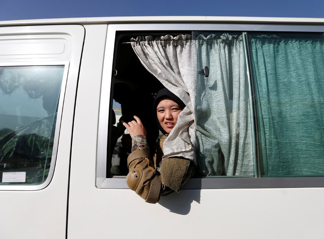 Zarmina Ahmadi, 22, a female soldier from the Afghan National Army (ANA) looks out from a bus window at the Kabul Military Training Centre (KMTC) in Kabul, Afghanistan October 26, 2016. (Photo by Mohammad Ismail/Reuters)