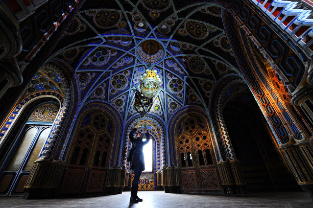A visitor takes pictures inside the Castle of Sammezzano during a special opening to the public of the palazzo in Leccio, Province of Florence, Italy, 06 December 2015. The palazzo in Tuscany that was first built in 1605 has 365 rooms decorated in Moorish Revival architectural style. The castle, which has been closed for years, was recently auctioned off. (Photo by Maurizio Degl'innocenti/EPA)