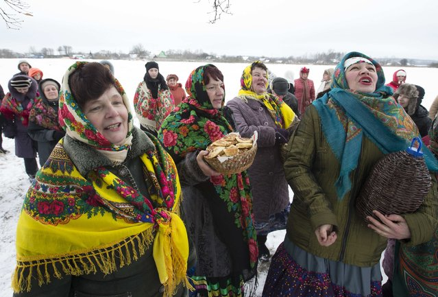Villagers take part in Kolyada holiday celebrations in the village of Martsiyanauka, east of the capital Minsk, January 21, 2015. Local residents took part in the celebrations to mark the end of a pagan winter holiday Kolyada, which over the centuries has merged with Orthodox Christmas celebrations. (Photo by Vasily Fedosenko/Reuters)