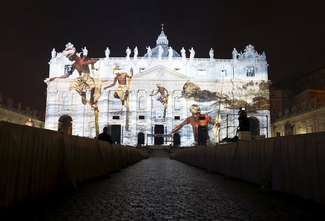 """A picture by U.S. photographer Steve McCurry, part of an art projection featuring images of humanity and climate change artistically rendered by Obscura Digital, is projected onto the facade of St. Peter's Basilica, as part of an installation entitled """"Fiat Lux: Illuminating our Common Home"""" as a gift to Pope Francis on the opening day of the Extraordinary Jubilee, at the Vatican, December 8, 2015. (Photo by Stefano Rellandini/Reuters)"""