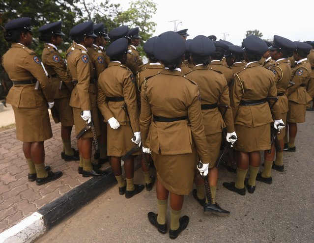 Women police officers are instructed by a police officer about their parade before a rehearsal for Sri Lanka's 67th Independence Day celebrations in Colombo February 2, 2015Dinuka Liyanawatte