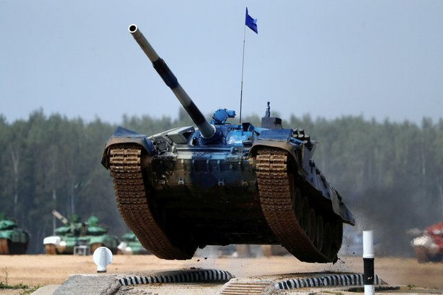 A T-72 tank operated by a crew from Kazakhstan jumps during the Tank Biathlon competition at the International Army Games 2018, in Alabino outside Moscow, Russia on July 28, 2018. (Photo by Sergei Karpukhin/Reuters)