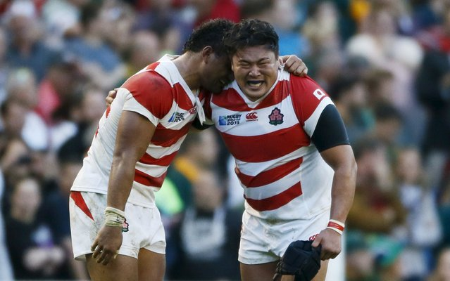 Japans Hiroshi Yamashita (R) celebrates victory against South Africa during their IRB Rugby World Cup 2015 Pool B match at the Brighton Community Stadium, Brighton, Britain, September 19, 2015. (Photo by Stefan Wermuth/Reuters)