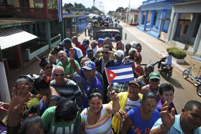 People are transported to greet the caravan carrying the ashes of Fidel Castro in Colon, Cuba, November 30, 2016. (Photo by Alexandre Meneghini/Reuters)