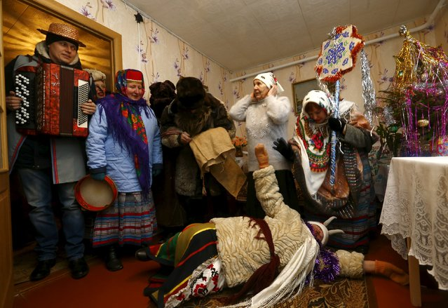 "People celebrate the pagan rite called ""Kolyadki"" in the village of Skirmantava, Belarus, January 7, 2016. (Photo by Vasily Fedosenko/Reuters)"