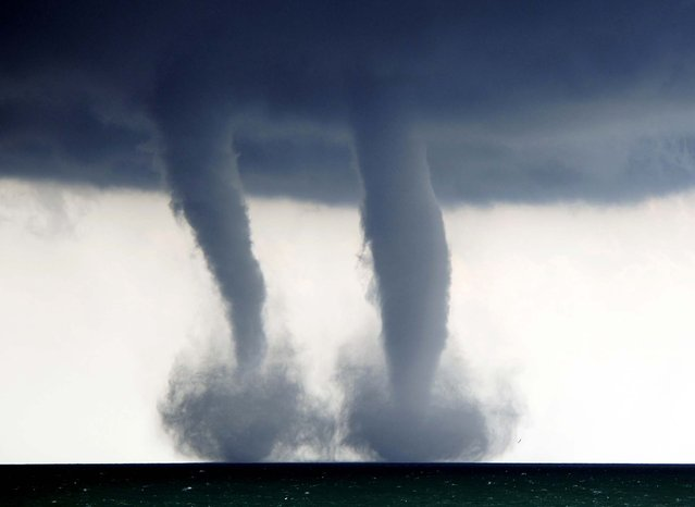 A pair of water spouts form on Lake Michigan southeast of Kenosha, Wisconsin, on September 12, 2013. The National Weather Service in Sullivan said the water spouts occurred about four miles southeast from Kenosha. (Photo by Kevin Poirier/The Kenosha News)