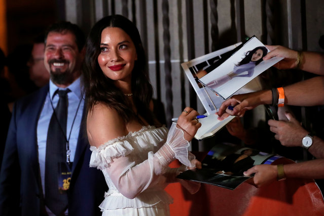 Actor Olivia Munn signs autographs at the premiere of The Predator during the Toronto International Film Festival (TIFF) in Toronto, Canada on September 7, 2018. (Photo by Mario Anzuoni/Reuters)