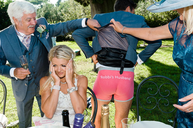 Husband wears underwear to show that he is now married to his wife. (Photo by Riccardo Bestetti/Caters News Agency/ISPWP)