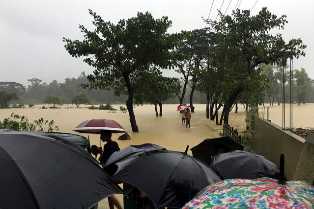 A road is flooded after heavy rain in Cox's Bazar, Bangladesh, July 25, 2018. (Photo by Clare Baldwin/Reuters)