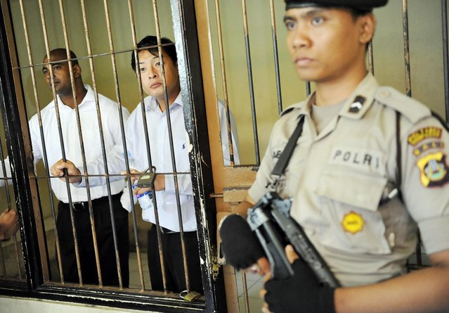Death row prisoners Andrew Chan (C) and Myuran Sukumaran (L) of Australia wait to attend a review hearing in the District Court of Denpasar on the Indonesian island of Bali, in this October 8, 2010 file picture. The two convicted drug smugglers were transferred on March 4, 2015, from a Bali prison to an island for execution along with other foreigners, underlining Indonesia's determination to use the death penalty despite international criticism. Mandatory credit. REUTERS/Nyoman Budhiana/Antara Foto/Files