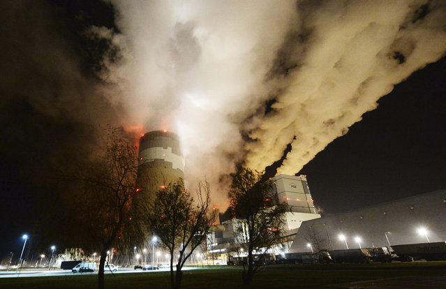 In this Wednesday November 28, 2018 file photo, clouds of smoke over Europe's largest lignite power plant in Betchatow, central Poland. Energy experts were working to restore full operations at Poland's biggest power plant, the lignite-fueled Belchatow, after an energy network failure switched off 10 of the plant's 11 units. Poland needed energy imports from Germany, Sweden, the Czech Republic and Slovakia to fill in for the suddenly missing power. (Photo by Czarek Sokolowski/AP Photo/File)