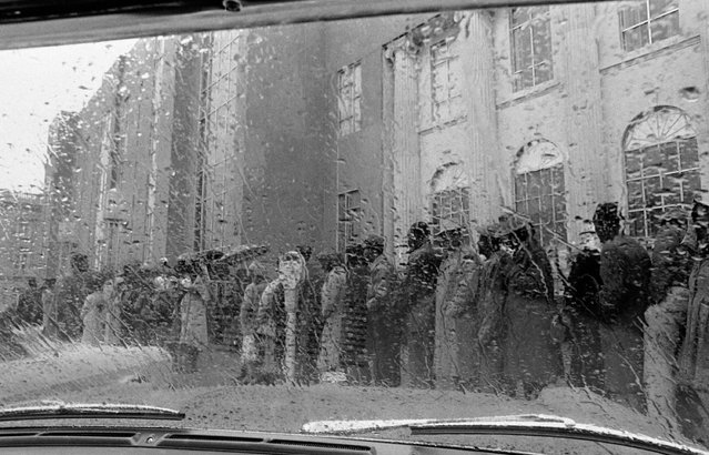 In this February 17, 1965 file photo, African Americans stand in line in the rain to try to register for a voter registration test in Selma, Ala. (Photo by AP Photo)