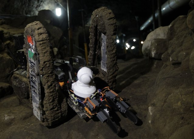 A robot used to explore ruins is seen on the entrance of a tunnel in the archaeological area of the Quetzalcoatl Temple near the Pyramid of the Sun at the Teotihuacan archaeological site, about 60 km (37 miles) north of Mexico City April 22, 2013.A robot has discovered three ancient chambers at the last stretch of unexplored tunnel at Mexico's famed Teotihuacan archaeological site on Monday, the first robotic discovery of its kind in the Latin American country. Named Tlaloc II after the Aztec god of rain, the robot was first lowered into the depths of the 2,000-year-old tunnel under the Quetzalcoatl Temple to check it was safe for human entry. After months of exploration, the remote-controlled vehicle has relayed back video images to researchers of what appears to be three ancient chambers located under the Mesoamerican city's pyramid. (Photo by Henry Romero/Reuters)