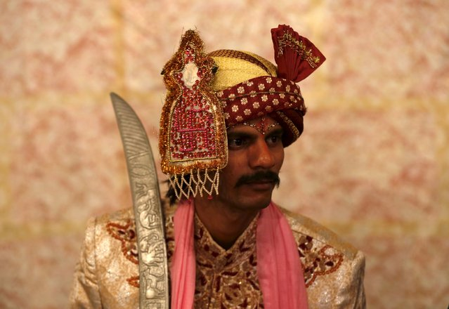 A groom in traditional dress waits for his wedding to start during a mass marriage ceremony in Karachi, Pakistan, January 24, 2016. (Photo by Akhtar Soomro/Reuters)