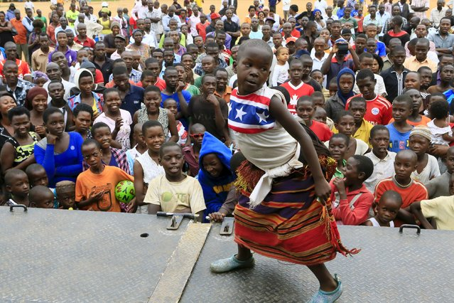 A girl entertains supporters of Amama Mbabazi, former Ugandan prime minister and presidential candidate for The Democratic Alliance (TDA), with traditional dance during a campaign rally ahead of the February 18 presidential election, in Lyantonde town, Uganda January 25, 2016. (Photo by James Akena/Reuters)