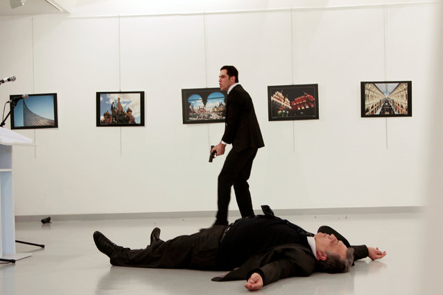 Russian Ambassador to Turkey Andrei Karlov lies on the ground after he was shot by unidentified man at an art gallery in Ankara, Turkey, December 19, 2016. (Photo by Hasim Kilic/Reuters/Hurriyet)